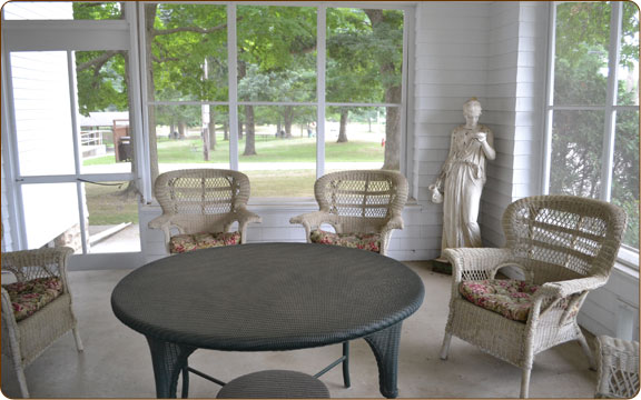 The Screened in Sun Room was a popular place on warm summer days